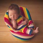 Beautiful newborn baby boy, sleeping in a chair.