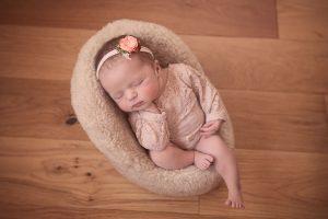 newborn-baby-girl-asleep-in-chair