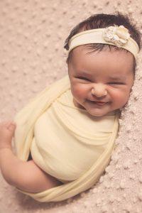 newborn-baby-girl-sleeping-smiling