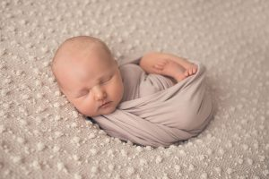 newborn-baby-girl-swaddled-sleeping