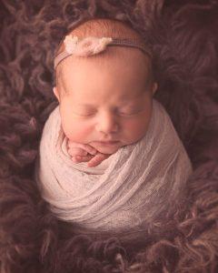 Newborn baby girl swaddled