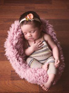 newborn-baby-girl-sleeping-in-chair