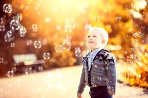 3-year-old-boy-blowing-bubbles