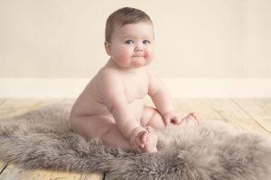 baby-boy-sitting-on-rug