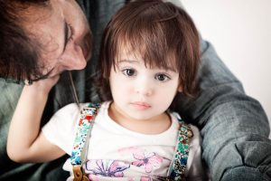 father-daughter-embracing-family-studio-portraits