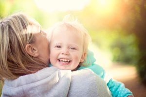 mother-daughter-smiling-cuddling-autumn-family-portraits