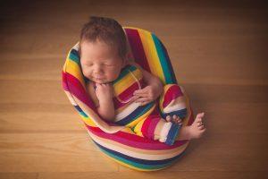 Newborn baby boy sleeping in a chair