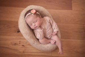 newborn-baby-girl-asleep-in-chair