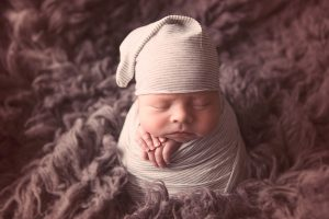 newborn-baby-boy-swaddled