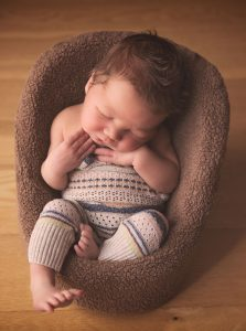 newborn-baby-boy-sleeping-in-chair