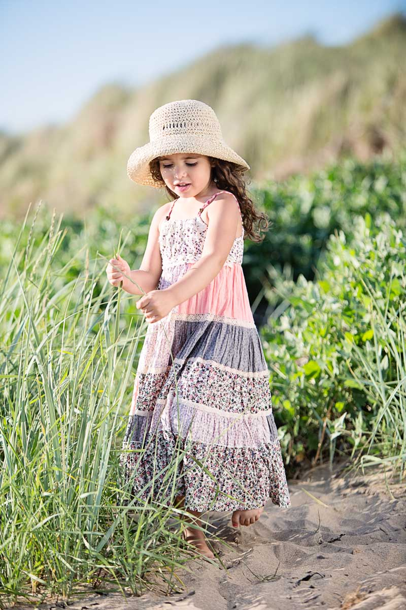 Girl in sundress with sun hat