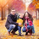 Family in autumn trees at Glasgow Green family photo shoot