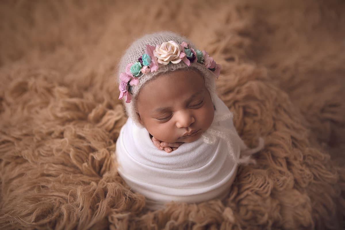 Sleeping newborn baby in potato sack pose