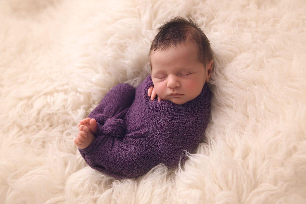 sleeping baby swaddled in Glasgow newborn photoshoot